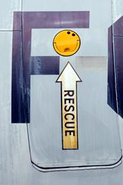 """A door on the side of the Lockheed EC-121D """"Warning Star"""" at the Aerospace Museum of California. I couldn't resist the happy face!    From the story: Volunteers restore WWII aircraft"""