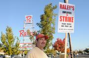 The first day of the Raley's strike. I knew we'd need photos, so I stopped at the Freeport Boulevard. Raley's to capture workers on strike. Robert Barbieri of United Food and Commercial Workers 8 agreed to let me photograph him. The story covered the first day of the strike.