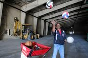 Dwayne Jackson of Jackson Sports Academy leased 72,000 square feet of warehouse space at McClellan Business Park for youth soccer and other sports. I asked him to bring some props for the photo. After talking with Jackson for a while, he told me he could juggle. That sounded like great way to make a more interesting photograph. With the backhoe parked along the wall, I think you can tell that the warehouse is being renovated. The sports complex is scheduled to open Dec. 1.  The story was about the growth of Jackson Sports Academy.