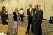 Sacramento Business Journal Publisher Terry Hillman networks before the annual Partners in Philanthropy event.