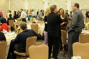 Two dozen companies of all sizes were honored for their support of charitable efforts in the capital region at the annual Partners in Philanthropy awards. Here, attendees wait for the awards luncheon to begin.