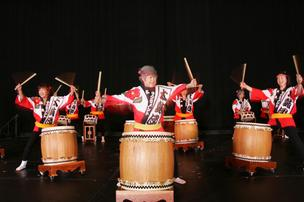 Performers from Sacramento Taiko Dan, a traditional Japanese drum group, perform.