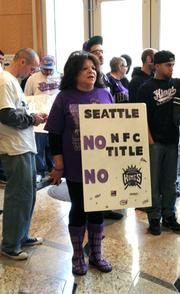 Sacramento Kings fans wait at City Hall before Mayor Kevin Johnson's news conference. Fans were encouraged to wear purple in support of the efforts to keep the Kings in town.