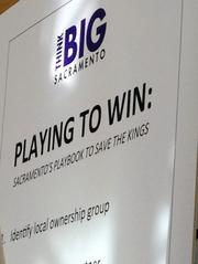 Sacramento is playing to win and keep the Kings, according to this sign.