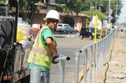 Julio Aleman of J & R Fence Co. works to install a fence between L and J Streets. Dozens of new parking spots are being added in midtown along a Union Pacific Railroad corridor. The first parking area willofficiallydebut at 9:30 a.m. on Friday.