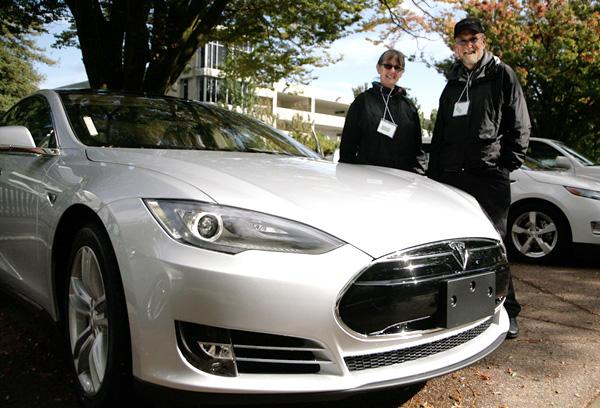 Tesla has installed a fast-charging station for its Model S at the Folsom Premium Outlets. The solar-powered station is part of the Tesla's proposed nationwide network of electric-car filling stations. In this file photo, a couple stands with their new Tesla Model S at the SARTA CleanStart Showcase.