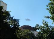 Business in Sacramento slowed to a halt Friday morning as workers gathered on Capitol Mall and perched atop parking structures to catch a glimpse of space shuttle Endeavour's final flight.