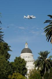 The Endeavour buzzes Sacramento's Capitol Building.