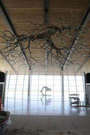 """A large """"chandelier"""" just out side the TSA checkpoint area, right, is made to look like a valley oak."""