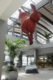 While hares and rabbits are native to the region, only one 56-foot red rabbit will point the way toward baggage claim.
