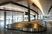The maple ceiling in baggage claim mimics the ceiling in the terminal.