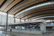The ceiling of the terminal is enhanced by redwood recycled from the old Franklin Boulevard/Thornton Road Bridge.