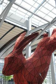 Artist Lawrence Argent designed Central Terminal B's red rabbit. It took about a dozen contractors 11 weeks to complete the on-site portion of its construction.