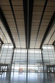 The terminal's glass walls are 50 and 60 feet high.