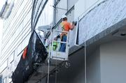 Construction workers install moisture- and mold-resistant glass at the future Sutter Women's and Children's Center.