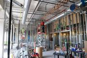 Construction workers install pipes in the 242-bed women's and children's center under construction at Sutter's midtown location. The center is targeted for completion in 2013.