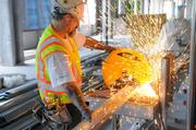 Ty Davis cuts metal studs at Sutter's women's and children's hospital, which is expected to open in 2013. Over the next three to five years, it is predicted that hospitals will generate 1,175 construction jobs and $173 million in total economic impact per year.