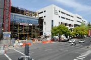 The Sutter women's and children's hospital, still under construction, connects to the existing main hospital with a spanning structure.