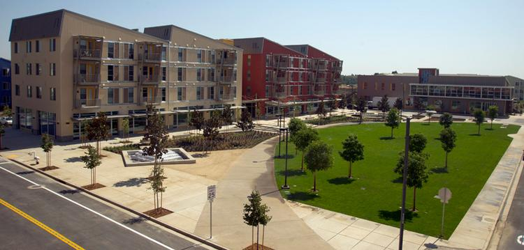 UC Davis West Village is the nation's largest planned zero net energy community, and a Dubai-based developer is using it as inspiration. Here, a hub of UC Davis West Village is the Village Square, with a mix of retail space and apartments in the space above.