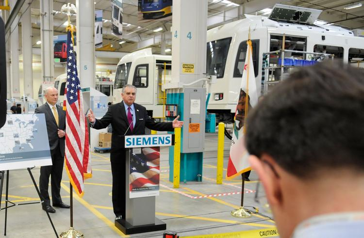 U.S. Secretary of Transportation Ray LaHood speaks during his tour of the Siemens light-rail vehicle manufacturing plant in Sacramento on Wednesday.