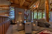 A home called Wovoka sold for $20.9 million in the Zephyr Cove area of Lake Tahoe, signaling the revival of the market for homes north of $15 million. This is the dining area of the home.