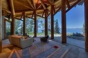 A home in the Zephyr Cove area of Lake Tahoe sold for $20.9 million. The custom-built Wovoka, completed in 2007, is largely made of whole logs. This is the living area, overlooking the lake.