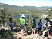 Hikers take in the view of Lake Mary near Donner Summit.
