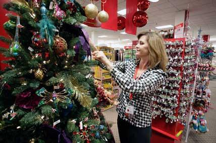 JCPenney Sunrise Mall department supervisor Karen Wood arranges items in the North Pole Trading Post section, left. The mall  is counting on new merchandise from JCPenney and other stores to boost holiday sales. Below, Hamilton Jewelers Pavilions stocks up on a few big-ticket items, just in case.