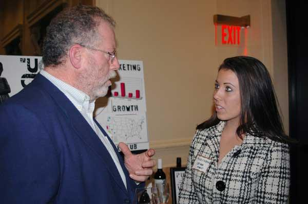 MBA student Ashley Coleman, right, discusses her project at the UOP showcase with Peter Quinn.