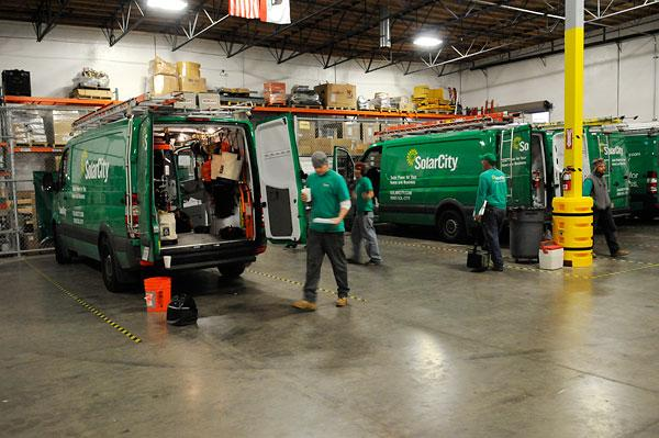 Ben McIntyre prepares the SolarCity van for the next day's job.