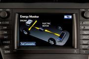 A dashboard monitor helps drivers of Toyota hybrid vehicles track electricity usage in the Prius.