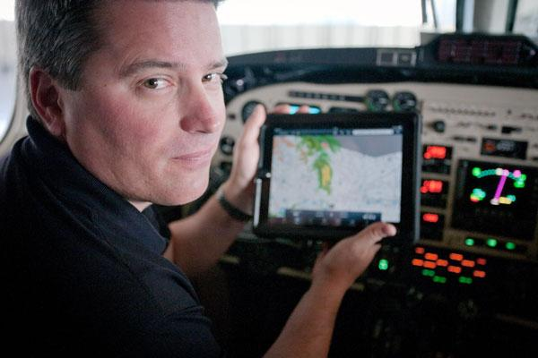 Axis Jet chief pilot Scott Malandrone uses an iPad to find navigation and safety information.