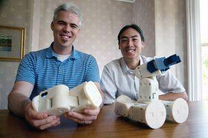 Barobo President Grant Ryland, left, and David Ko, head of software development, show the different configurations of Mobot.