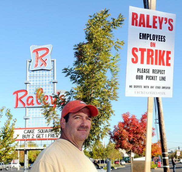 Robert Barbieri of United Food and Commercial Workers 8 pickets in front of the Raley's on Freeport Boulevard on Monday. Besides labor issues, Raley's Inc. is also struggling to compete in a changing and competitive industry.