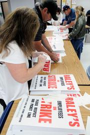 Patti Brown, left, and Jeff Berns prepare posters for the strike against Raley's that began Nov. 4.