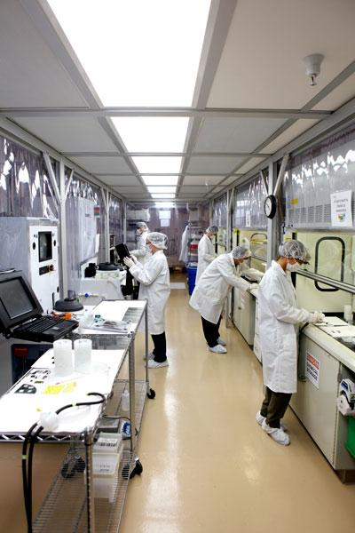 Bloo Solar employees work in the clean room at the company's El Dorado Hills facility. The company has raised $6.8 million in its latest round of funding.