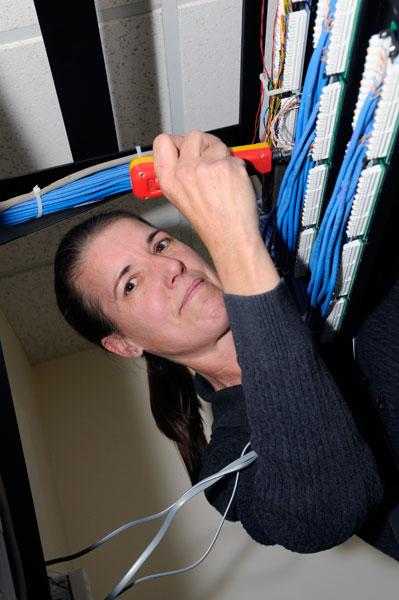 Gold Hill Communications' Jeanette Butler installs phone systems for small companies.