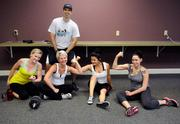 CrossFit Envy coach Jared Hasleton trains CLAS Information Service employees, from left, Sarah King, Nicole Jepsen, Varsik Karapetyan and Jolene Thomas.