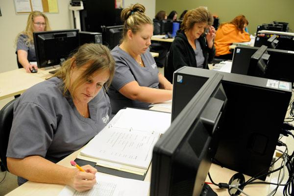 From left, Michelle Huxtable, Crystal Keiper and Yvonne McCauley study during their health care administration class at Carrington's Citrus Heights campus, which is adding more non-medical programs.
