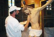 Iconographer Aurel Onut repainted the crucifix at the Cathedral of the Blessed Sacrament in downtown Sacramento.