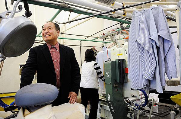 Eung Choi, left, president of the Korean Dry Cleaners Association, worked with the collaboration to help members such as Young Cho, owner of All Season Cleaners, comply with regulations.