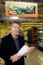 Kevin Cotter pooled his resources with other local residents to open New Earth Market in Yuba City.