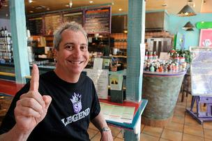 Bobby Coyote, owner of Dos Coyotes Bar and Grill, at his Davis restaurant. The company has been buying Kings season tickets since 1994.