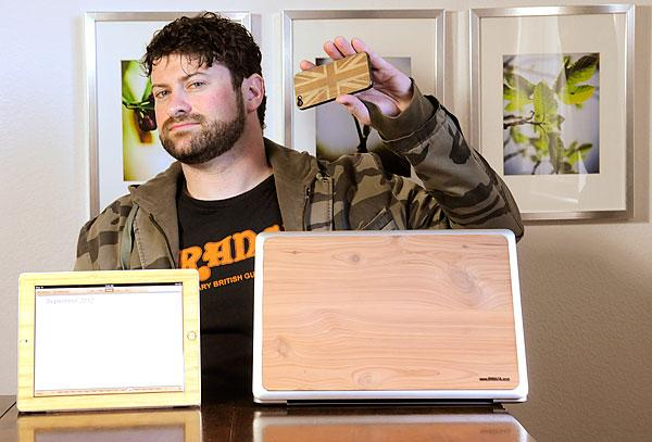 """Bark4's Glenn Cummins hand cut 200 samples of his wood iPhone cases. """"It wasn't great looking, but it was something usable I could show people,"""" he said."""