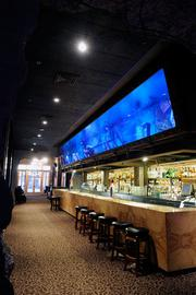 The K Street project that took a string of vacant buildings and turned them into successful restaurants and entertainment venues is up for sale. There are nine leases in the complex, including high-profile restaurants and bars such as Dive Bar, seen here.
