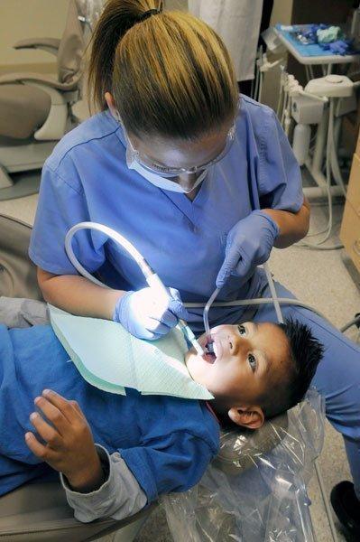 Dental assistant Denise Silva works on Anthony Ramirez at The Effort's pediatric dental clinic in North Highlands.