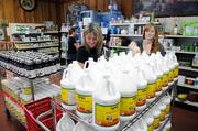 Joanna Bair, left, and Amber Elliott stock shelves at Elliott's Natural Foods, which uses Twitter and Facebook to engage customers.