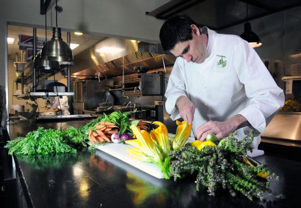 David English, chef of The Press, uses locally sourced products but says doing so is an act that requires balancing taste, availability and costs.