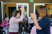Carole Greenwood, left, dances with Eskaton activity assistant BerleanLeedy.