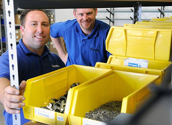 Jon Schultz, Fastenal Co. district manager, and Sean Luigs, government state specialist, say half of the construction and industrial supply company's sales come from fasteners, such as nuts, bolts and screws.